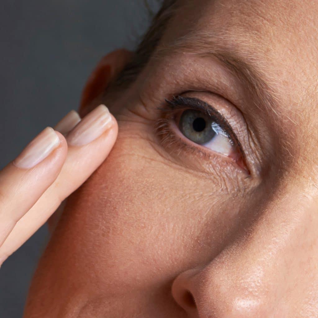 female eye touch