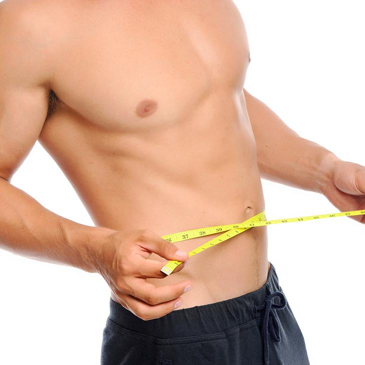 Male measuring slim waist