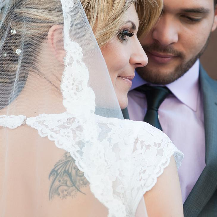 Female in wedding dress with tattoo